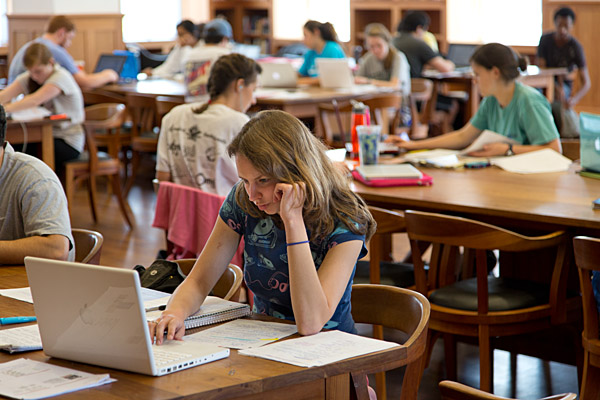 MLC Reading Room with students, closeup on young woman with laptop