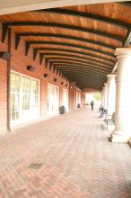 2nd Floor exterior colonnade and brick path