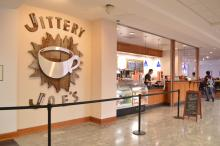 Jittery Joe's sign and  coffee counter
